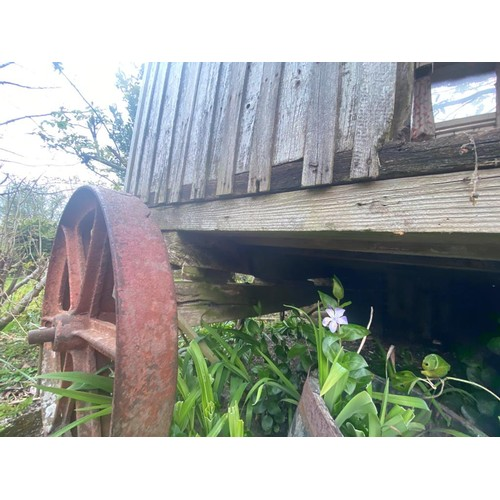 1 - A late Victorian/Edwardian shepherd's hut, of traditional design, on metal wheels For replacement, r...