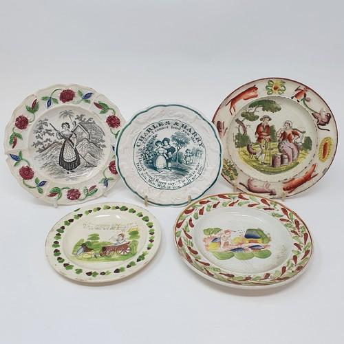 21 - A 19th century nursery plate, Charles & Harry, 13 cm diameter, and four other nursery plates (5)