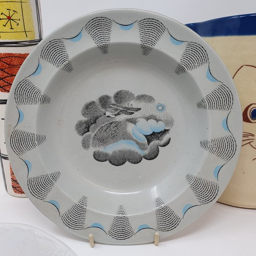 30 - A Wedgwood Edward Ravilious travel pattern bowl, 21 cm diameter, a jug, decorated cat, 20 cm, a roll...