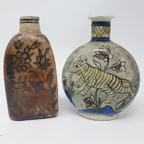 31 - An Iznik style bottle vase, decorated a cat, 17 cm high, and another, 18 cm high (2)