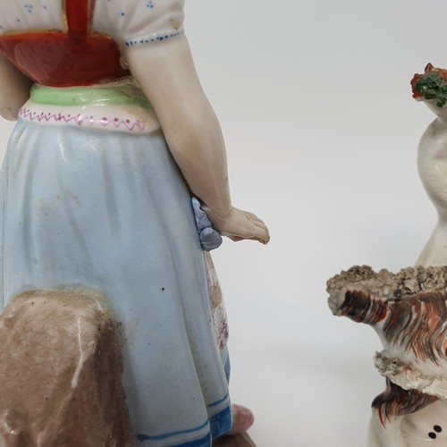 60 - A 19th century Staffordshire figure of a young girl holding flowers, 22 cm high, and other ceramics ...