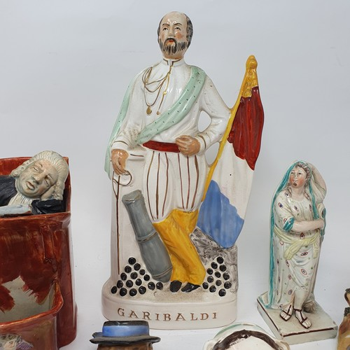 72 - A 19th century Staffordshire figure, the Vicar and Moses, lacking lower figure, 18 cm high, a Staffo...