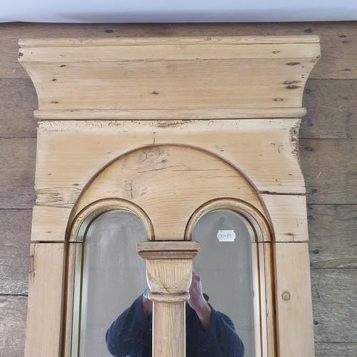 104 - A pine wall mirror, 104 x 48 cm