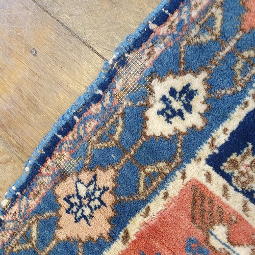 110 - A Persian blue ground rug, multiple borders, centered with six blossom shaped medallions, 150 x 110 ...