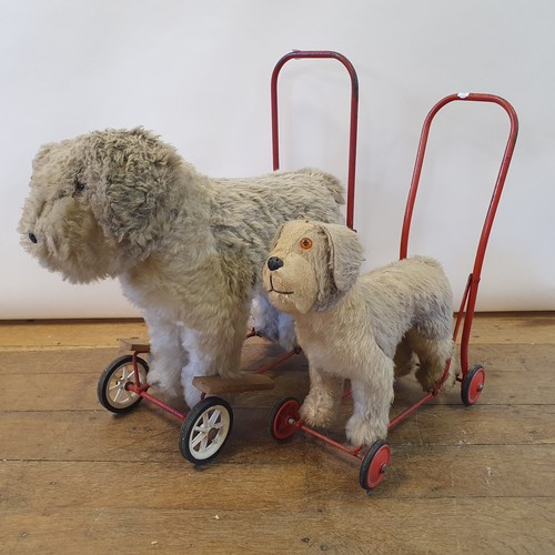130 - A 1950s push along dog toy, 62 cm high, and another, 55 cm high (2)