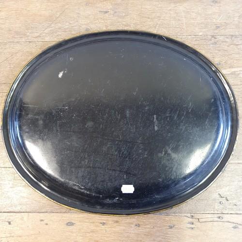 131 - A 19th century oval papier-mâché tray, highlighted in gilt, 65 cm wide
