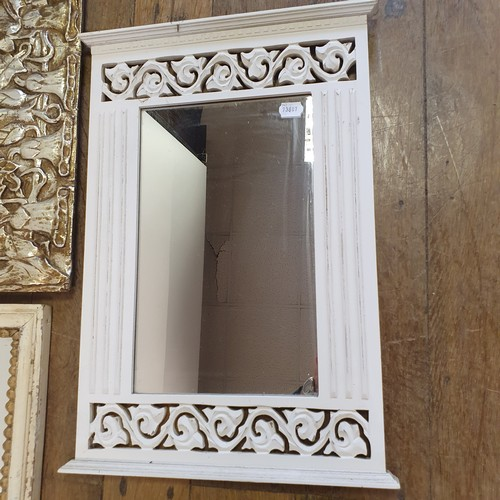 217 - An Art Nouveau style mirror, 72 x 51 cm, and two other mirrors (3)