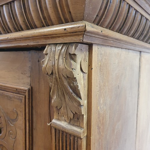 221 - A Continental walnut armoire, having two doors, above a single drawer, 185 cm high x 126 cm wide