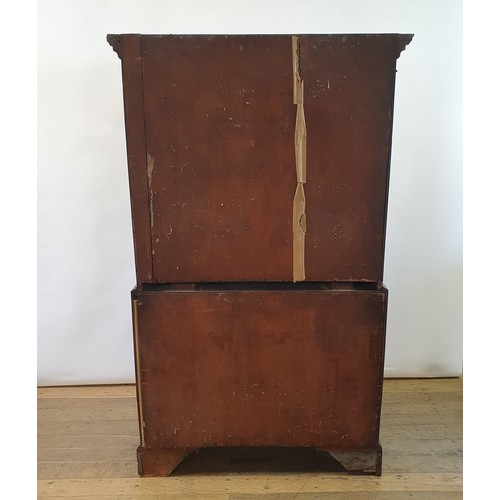 229 - A 19th century mahogany secretaire chest on chest, the top having two short and three long drawers, ...