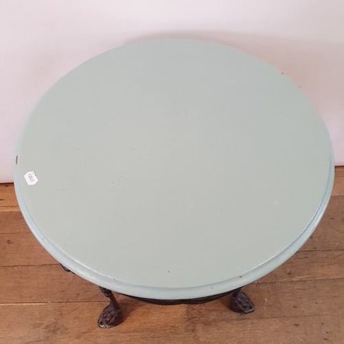 235 - An Art Nouveau cast iron pub table, raised on three legs united by undertier, with a later painted t...