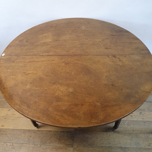237 - A 19th century mahogany dropleaf dining table, on square tapering legs, 130 cm diameter