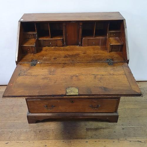 239 - A 19th century mahogany bureau, on bracket feet, 92 cm wide