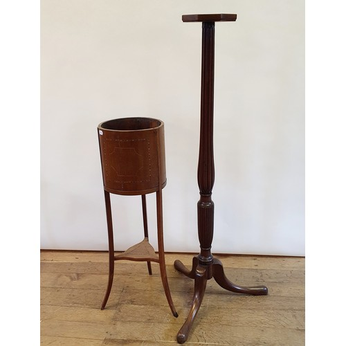 240 - An early 20th century mahogany jardiniere stand, 100 cm high, and a mahogany pedestal, 144 cm high (...