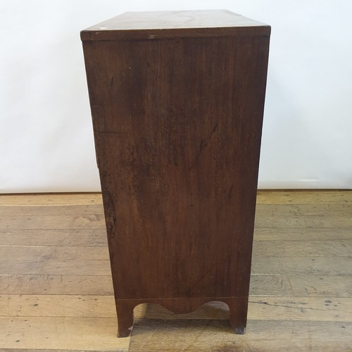 251 - A 19th century mahogany and crossbanded chest having two short and three graduated long drawers on s...