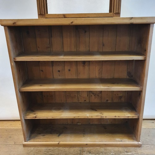 241 - A pine bookcase, 105 cm wide, and pine shelf, 65 cm wide (2)