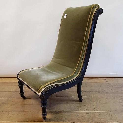 257 - A late 19th century ebonised nursing chair