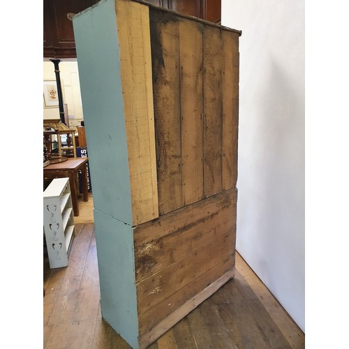 269 - A painted pine cupboard, having four doors, on a plinth base, 208 cm high x 109 cm wide