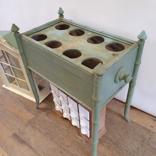 271 - A painted bottle stand, raised on faux bamboo legs, 64 cm wide, a painted wall cabinet, 51 cm wide, ...