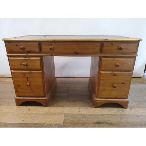 278 - A pine pedestal desk, 131 cm wide