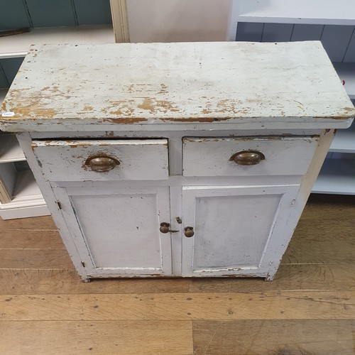 286 - A painted pine dresser base, having two short drawers and two cupboard doors, 92 cm wide, a painted ...
