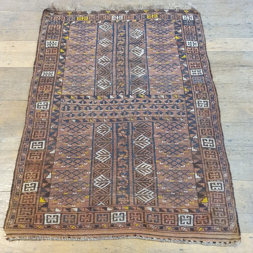 112 - A Persian red ground rug, multiple borders, centered with repeated geometric forms, 170 x 125 cm