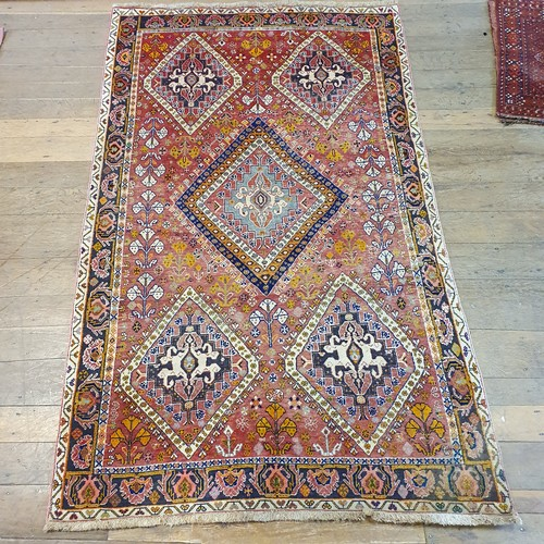 117 - A Persian red ground carpet, multiple borders, centered with five altering shapes medallions, 146 x ...
