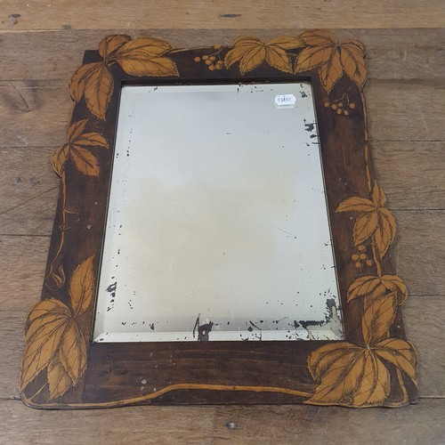 132 - A wall mirror, with penwork decoration, 58 x 45 cm