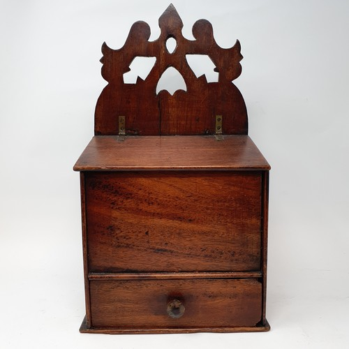 248 - A 19th century mahogany candle box, with fret carved back and a hinged lid above a drawer, 41 cm hig...