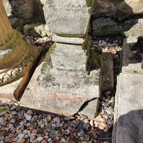 6 - A composite stone garden pedestal, 78 cm high, lacking top, various losses to base