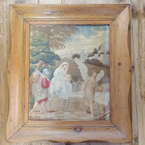 173 - A 19th century silkwood panel, Mary, Joseph, Jesus and donkey being led by an angel, 44 x 38 cm