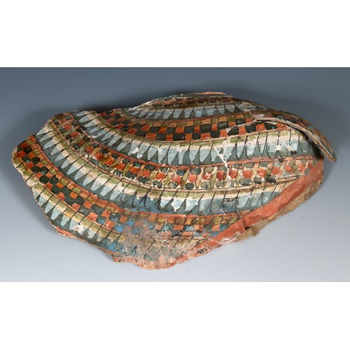 57 - An Egyptian style painted fragment, 30 cm wide, in glazed box