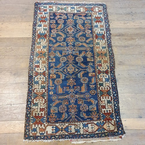 115 - A Persian rug, multiple borders, centre with stepped medallions, 171 x 108 cm