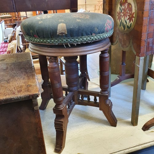 254 - An early 20th century walnut adjustable piano stool, an oak stool, a painted wood box, a rosewood si...