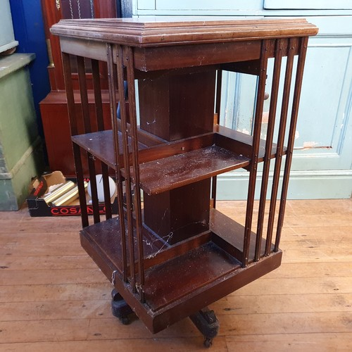 275 - An early 20th century mahogany revolving bookcase, 49 cm wide