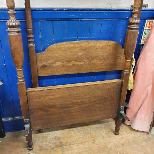 284 - A 19th century style painted cast metal double bedframe, and an oak single four poster bed