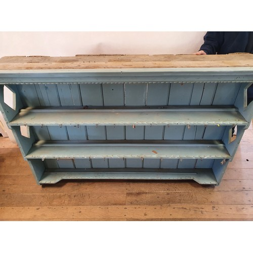 279 - A 19th century painted pine wall hanging plate rack, 168 cm wide and another (2)