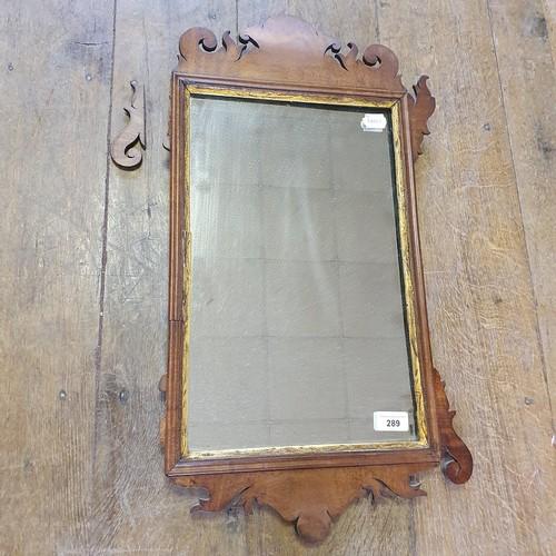 289 - A 19th century mahogany fret framed wall mirror, 66 x 40 cm