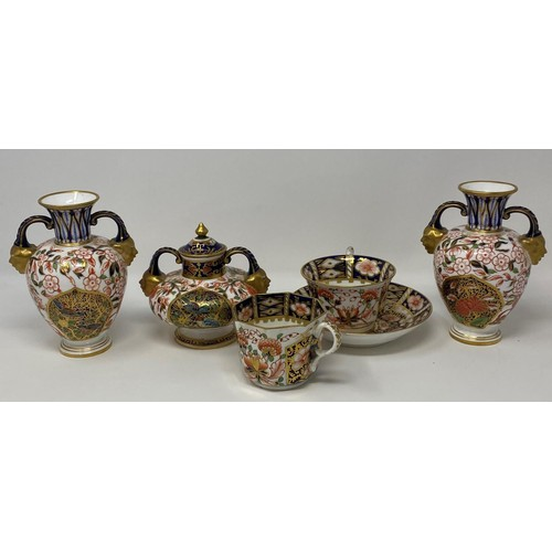 557 - A Royal Crown Derby Imari pattern vase, date mark for 1882, 10 cm high, a pair of vases, two cups an...