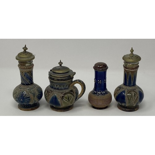 558 - A Doulton Lambeth three piece cruet, and a pepper pot, 9 cm high (4)
