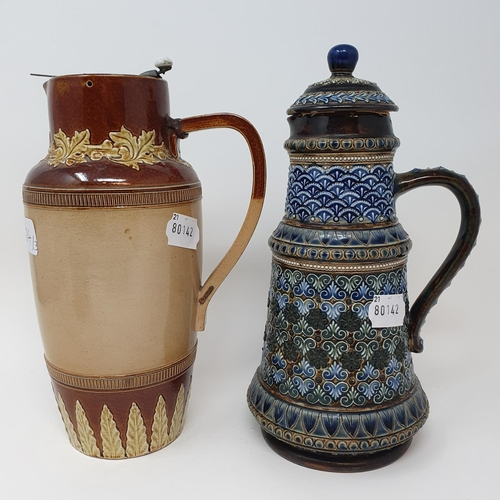 504 - A Doulton Lambeth jug and cover, decorated foliate forms, 26 cm high, a tobacco jar, 16 cm high and ...