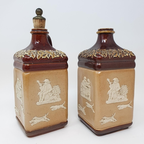 505 - A pair of Doulton Lambeth flagons, impresses Supplied to G.W. Scott & Sons Only and two Doulton ston...