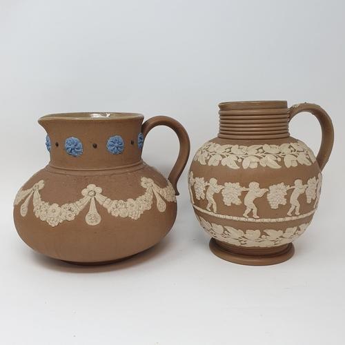 508 - A Doulton Lambeth tobacco jar, 15 cm high, and two Doutlon Lambeth jugs (3)