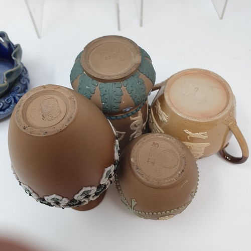 509 - A pair of Doulton Lambeth jugs, 15 cm high, and six other items of Doulton (8)