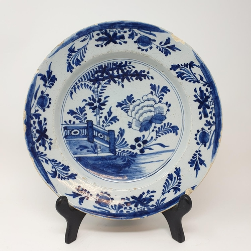 510 - A Delft plate, 31 cm diameter and two others (3)