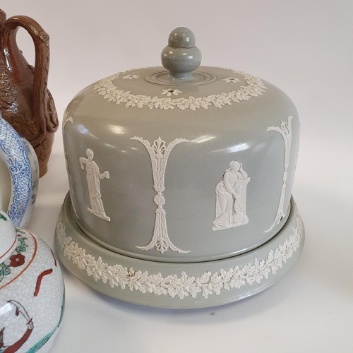 512 - A 19th century stoneware harvest jug, 27 cm high, a cheese dish and cover, and various other ceramic...