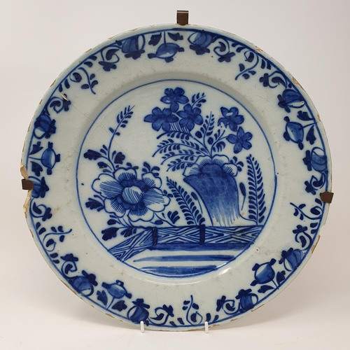 513 - A Delft blue and white plate, 35 cm diameter and four others (5)
