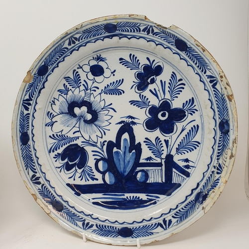 514 - A Delft blue and white plate, 30 cm diameter and three others (4)