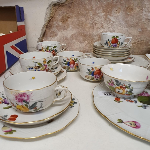519 - An Herend part tea service, comprising two plates, four side plates, seven cups and saucers, cream j...