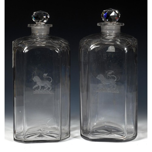 502 - A large pair of early 19th century glass decanters and stoppers, probably Irish, engraved lions ramp...