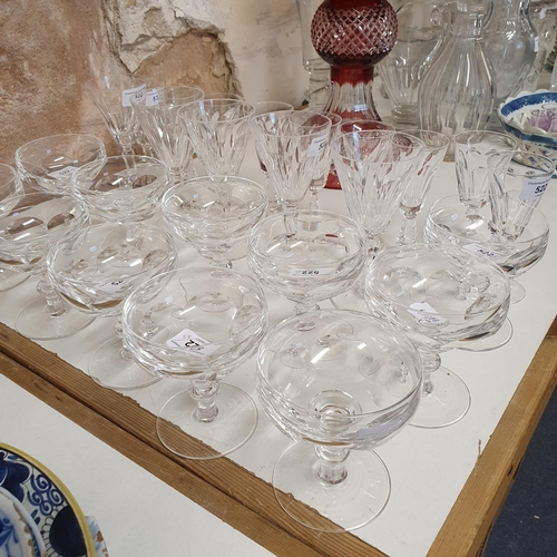 522 - A part suite of Waterford glass, comprising eleven coupe, five wine glasses and nine sherry glasses ...